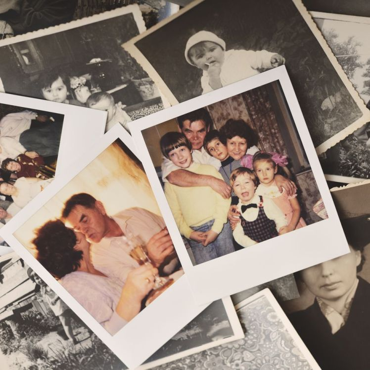 pile-of-family-photographs-on-table-overhead-view-royalty-free-image-1572282045.jpg